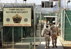 U.S. military guards walk within the Camp Delta military-run prison, at the Guantanamo Bay U.S. Naval Base, Cuba in 2006. / AP file photo