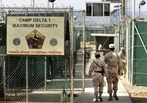 U.S. military guards walk within the Camp Delta military-run prison, at the Guantanamo Bay U.S. Naval Base, Cuba in 2006. / AP file photo